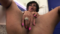 Stunning shemale Brisa gets naughty with her cock in a public bathroom