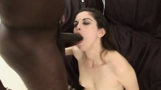 Pretty brunette with a lovely ass has a big black shaft taking her pussy to orgasm