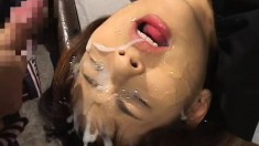 Beautiful Oriental girls taking heavy loads of sperm on their faces