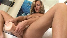 Sultry blonde Jordan Nevaeh goes for the gusto with a huge dildo to fuck