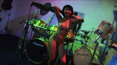 Raffie Korg does a striptease for the band after they finish playing