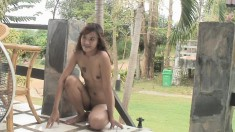Sexy Asian babe is outside posing on her patio with her naked body
