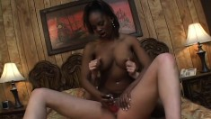 Interracial lesbian lovers share a pink sex toy and reach their climax