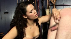 Nasty mistress makes him bend over with his nuts out and whacks them