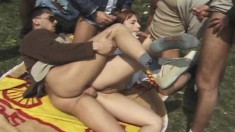 Enticing redhead gets banged rough and deep by horny guys in the park