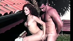 Shemale gets her tight ass pounded under the hot sun by a stud