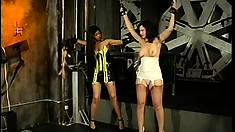 Dominating mistress ties up tits of white bitch slave and pets her clit