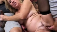Wild blonde milf in black stockings has two guys punishing her holes