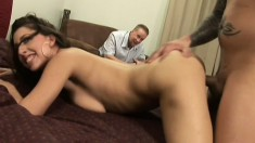 Gorgeous brunette with a spicy ass sucks and fucks a big cock in front of her man