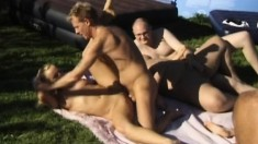 Two ravishing and luscious girls getting gangbanged in the outdoors