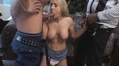 Uninhibited blonde gets fucked in the ass while a bunch of guys watch