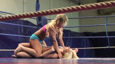 Lisa and Kelly Cat wrestle in the ring and go down for the pussy