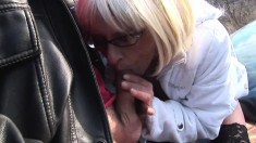 Mature blonde with glasses spreads her legs to get banged outdoors