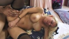 Nasty blonde in stockings engages in wild sex action with a black guy