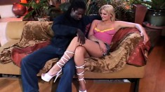 Young blonde cutie spreads her legs for a humongous black dong