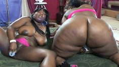 Ebony lesbian plumpers get oiled up for some heavy duty toy fucking