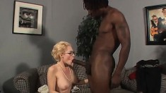 Big breasted blonde cougar in heat surrenders her cunt to a dark stud