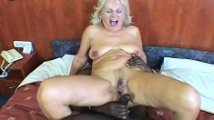 Busty milf plays with a dildo and then gets hammered by a black stud