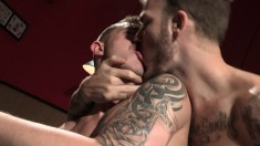 Two tattooed studs open their assholes wide for a vigorous ass-fucking