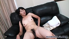 Her bushy bush is getting very juicy as she vibes it with sex toys