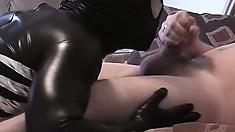 Spiderman jerks his stiff boner as the evil villain Venom licks his balls