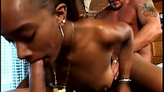 Enticing black girl has three guys drilling her holes and filling her mouth with cum