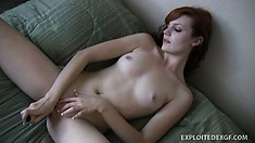 Alluring redhead with tiny boobs Nicki spreads her legs and masturbates with a dildo