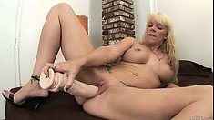 Heidi Mayne chooses a huge toy to fuck her wet pussy in a hot solo video