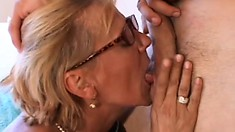 Lustful and horny, a naughty blonde cougar passionately sucks and fucks a big cock