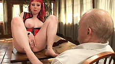 Big-tittied red-haired whore gets her feet licked and mouth fucked