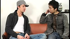Skinny Asian dude gives a hung white guy a nice sloppy blowjob