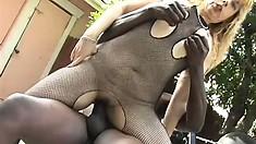 Slutty old blonde broad cops a squat on a big black member outdoors