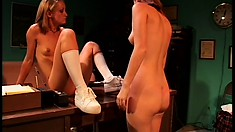 Two bored eye candies in schoolgirl uniforms play with each other's pink slits