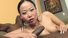 Asian cutie has a massive black dick exploring every inch of her pussy