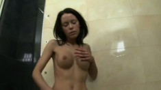 Cute young brunette with big tits make herself cum hard in the bathtub